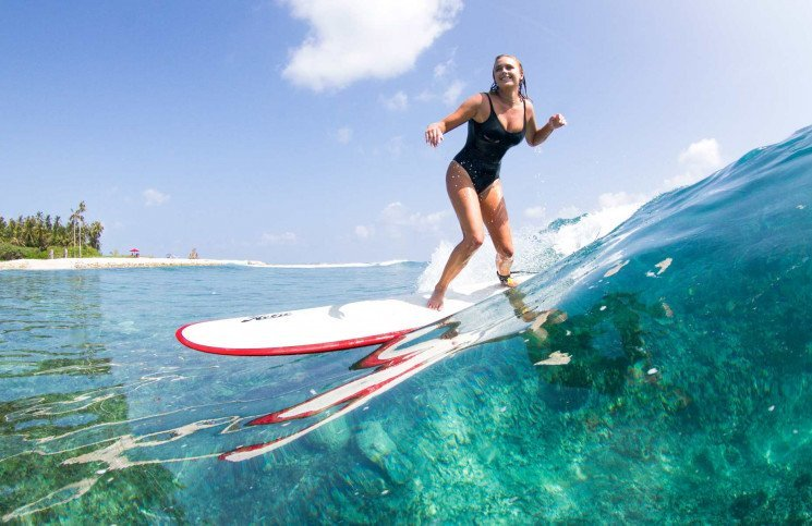 Ellie-Jean Coffey Surfing in front of Niyama Luxury Resort in the Maldives
