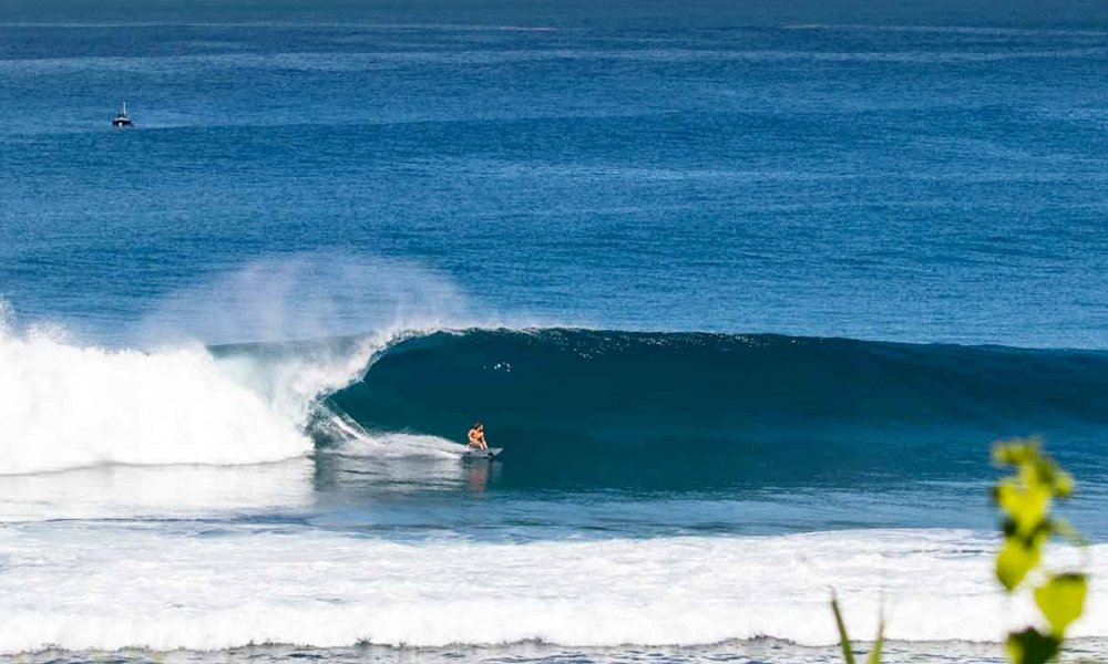 Surfing perfect walls in Sumba