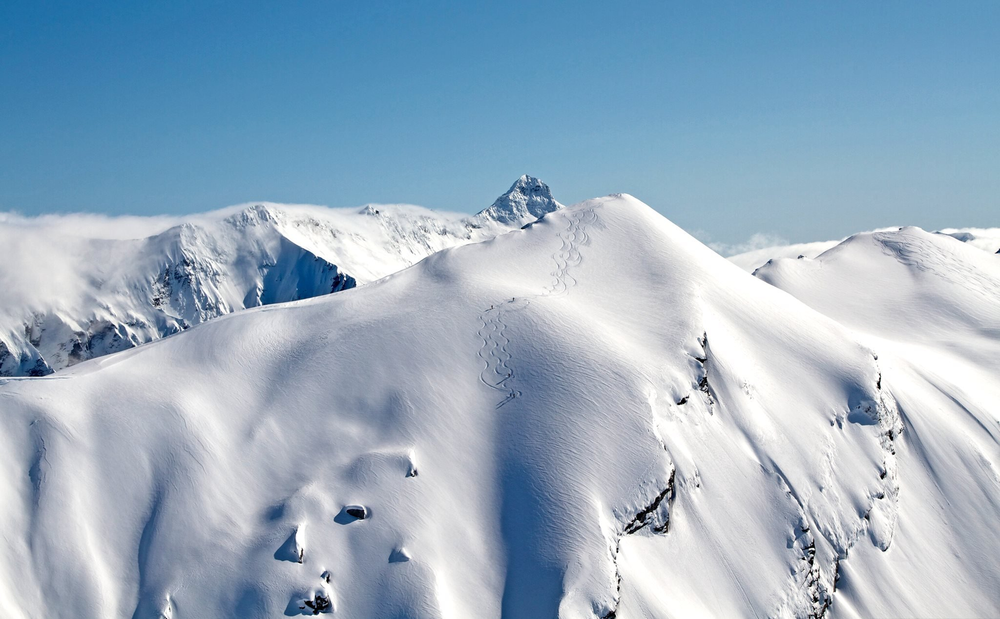 Go heliskiing on the highest peaks without crowds.