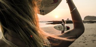 Sunset surfing girls in Nicaragua