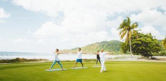 surfing and yoga in peace on the beach