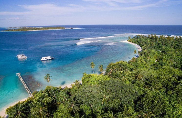 Surfing in the Maldives on board a surf charter.