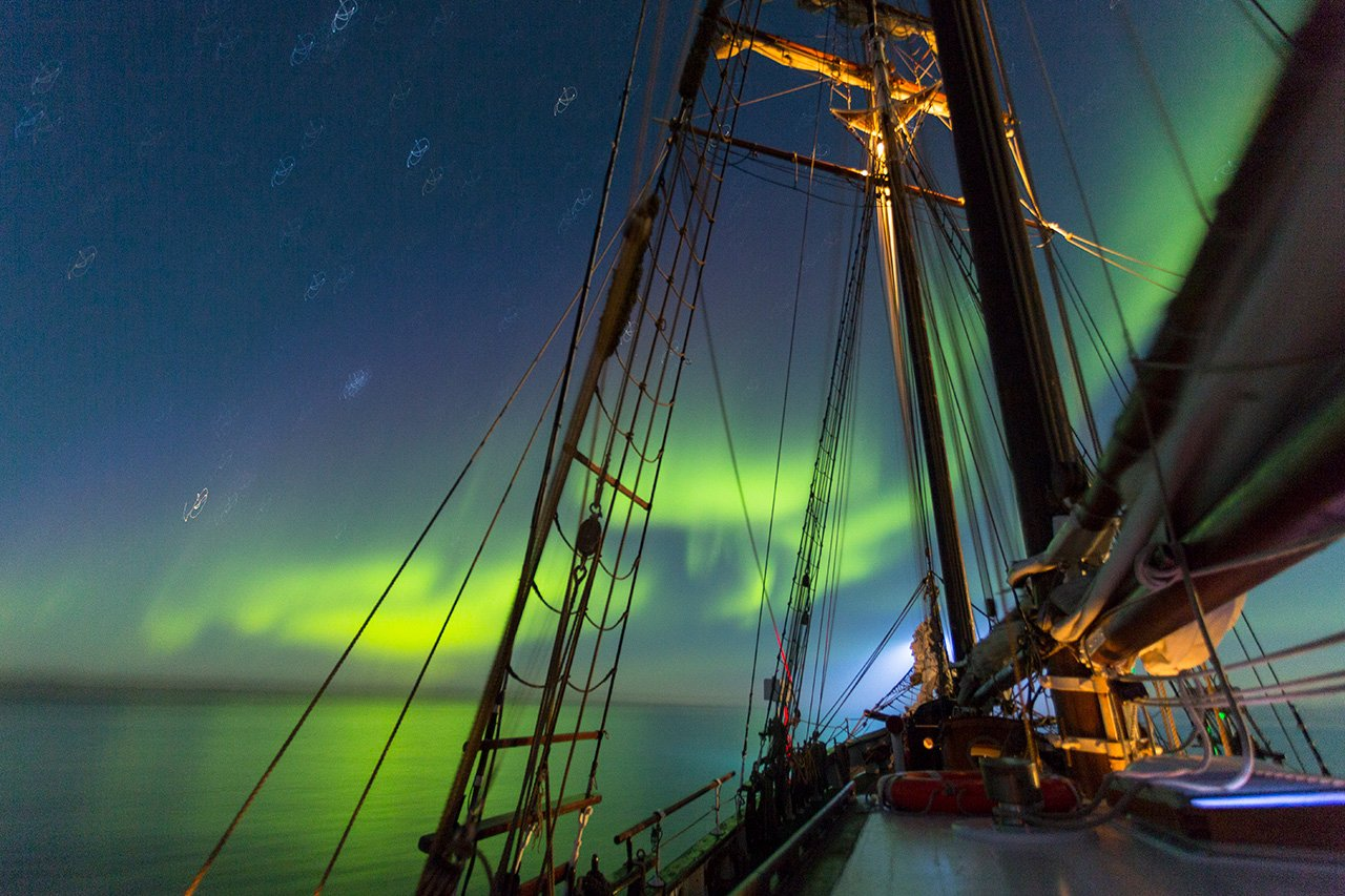 See the arctic lights from your sail boat at night.