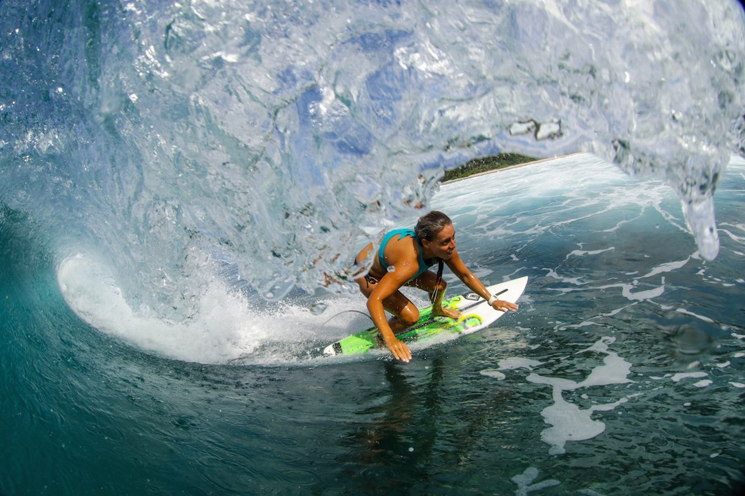 Female surfer in the Mentawais