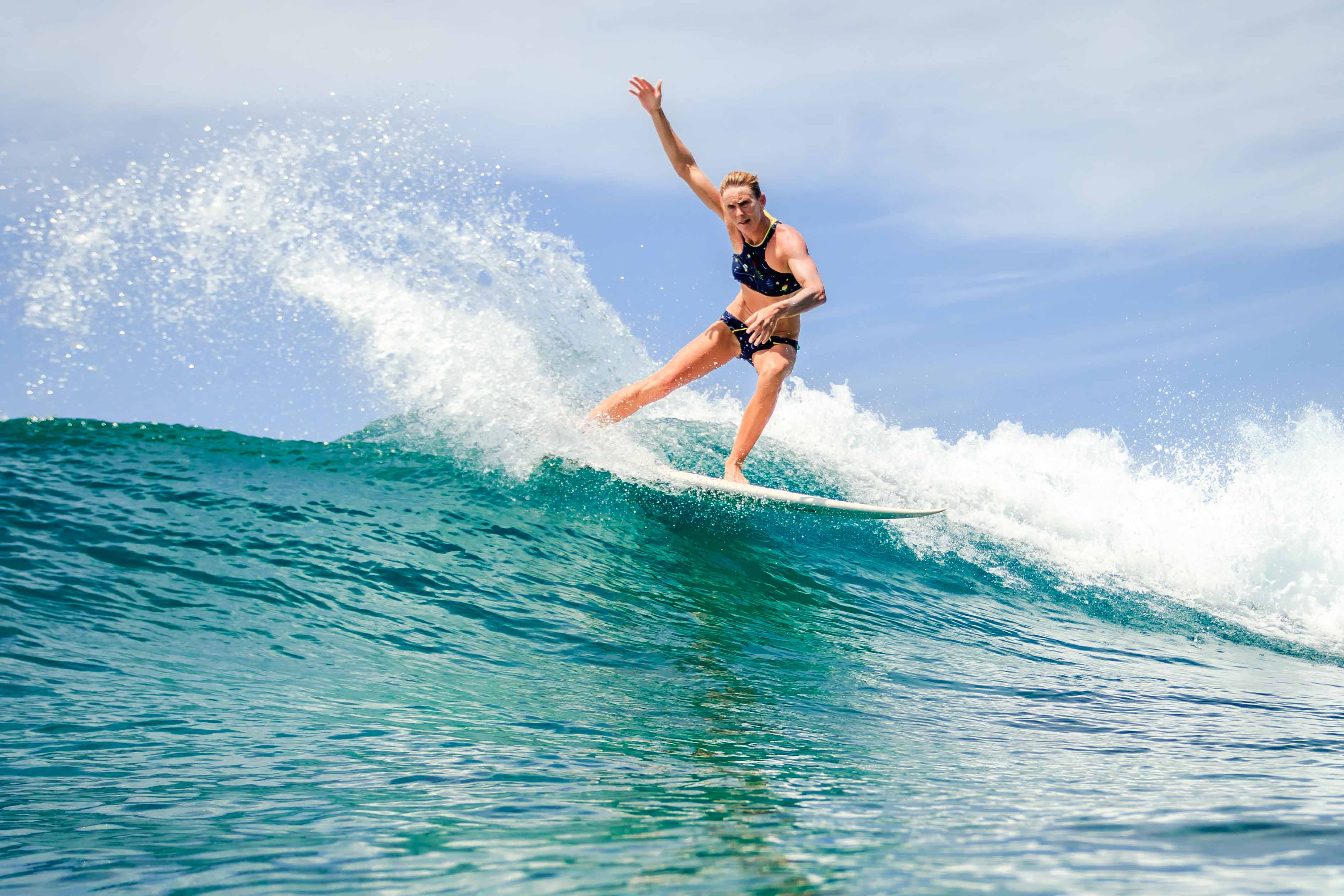 Girl surfing in the Maldives