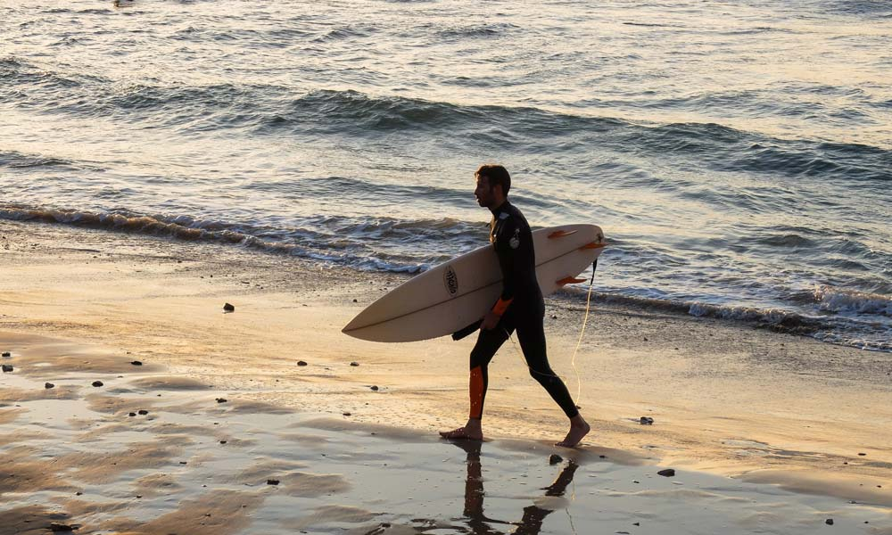Man with short surfboard